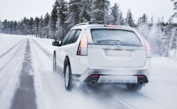 SUV driving through snow