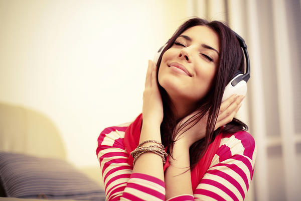 woman listening headphones